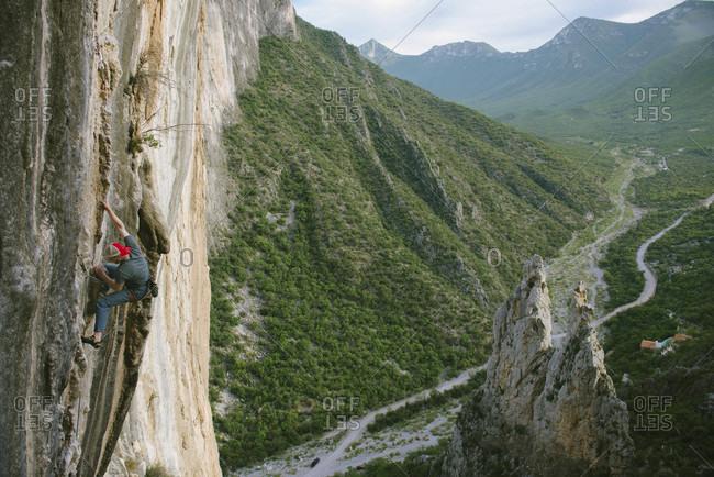El Potrero Chico, Monterrey, Mexico - December 25, 2014: Rock climber climbing cliff on Celestial Omnibus (512a) climbing route at El Portero Chico, Monterrey, Mexico