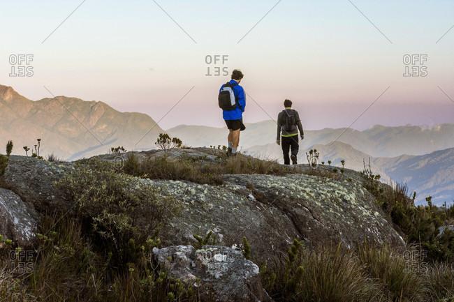 Tres Picos State Park, Rio de Janeiro, Brazil - September 16, 2017: Two men hiking in Tres Picos State Park, Rio de Janeiro, Brazil