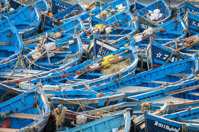 Essaouira, Marrakech-Safi, Morocco - December 18, 2016: Blue fishing boats in Essaouira fishing port, Marrakesh-Safi, Morocco