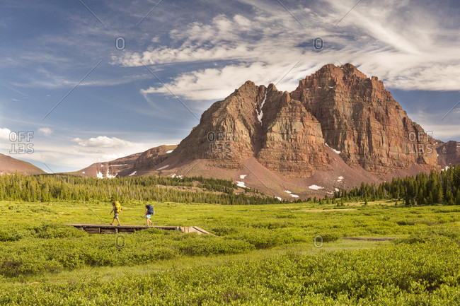 Uinta Mountains, Utah, USA - July 9, 2016: Backpackers hiking near Red Castle mountain