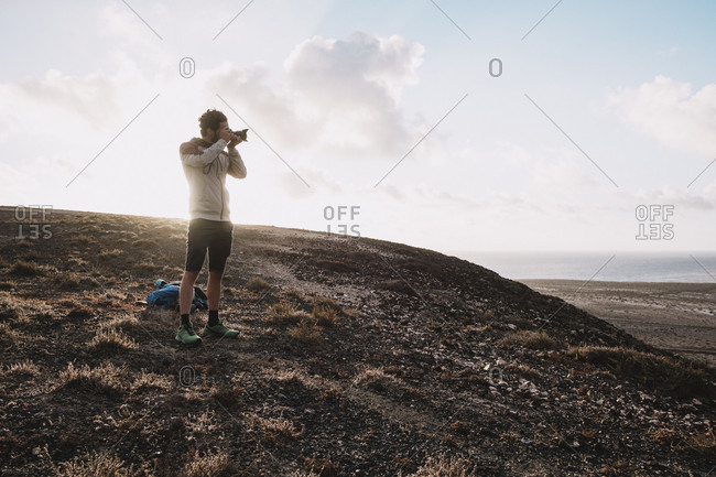 Lanzarote, Canary Islands, Spain - July 5, 2017: Photographer taking picture in desert landscape,