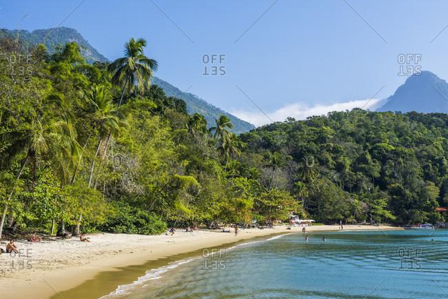 Ilha Grande, Rio de Janeiro, Brazil - February 16, 2018: Tropical beach with palm trees