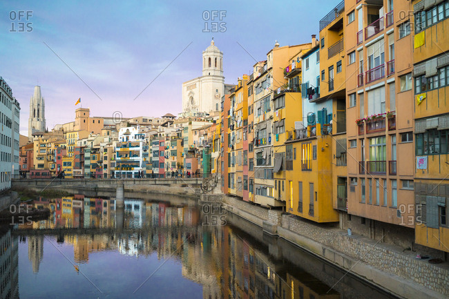 Girona, Spain - December 31, 2017: Cathedral and houses along the River Onyar in the evening