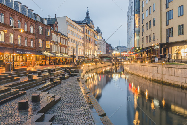Aarhus, Denmark - December 30, 2017: View to lighted city with Aarhus River