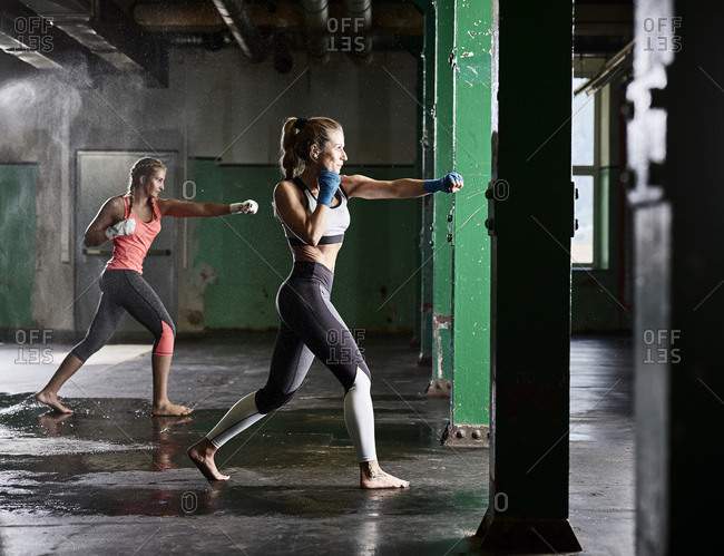 Two women having martial arts training