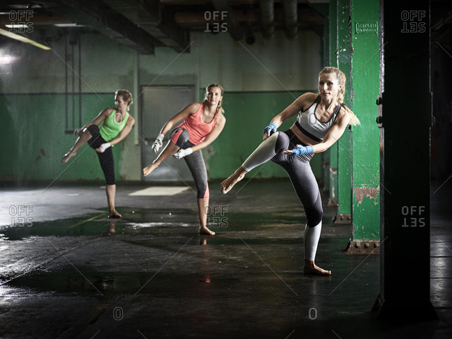 Three women having a workout in a hall