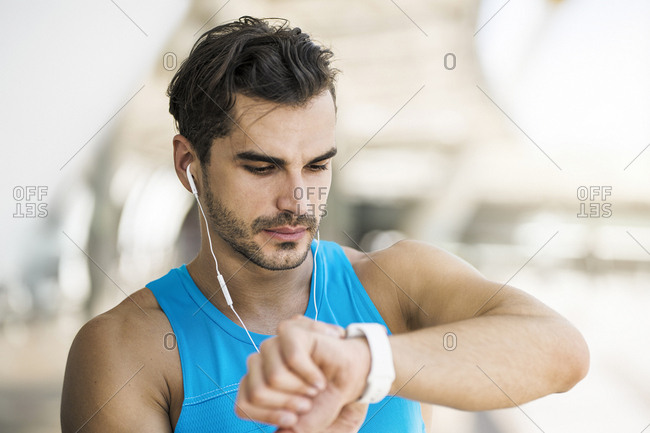 Athlete checking his smartwatch