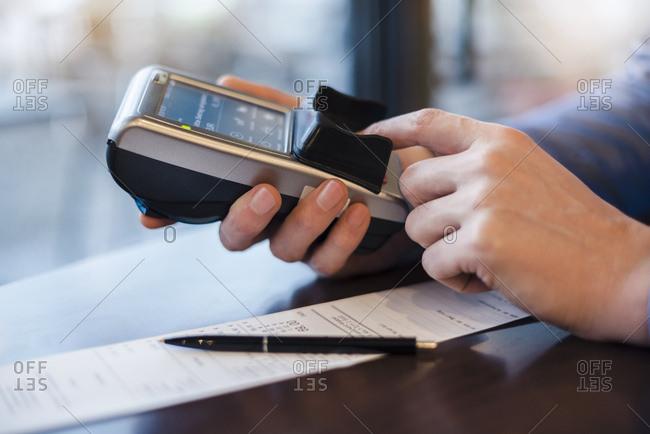 Man using credit card reader- close-up