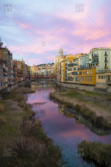 Spain- Catalunya- Girona- Cathedral and houses along the River Onyar in the evening