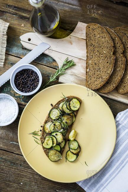 Bruschetta and various ingredients- rye bread- zucchini- rosemary- garlic