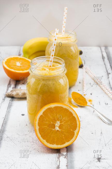 Orange banana smoothie with ginger and curcuma