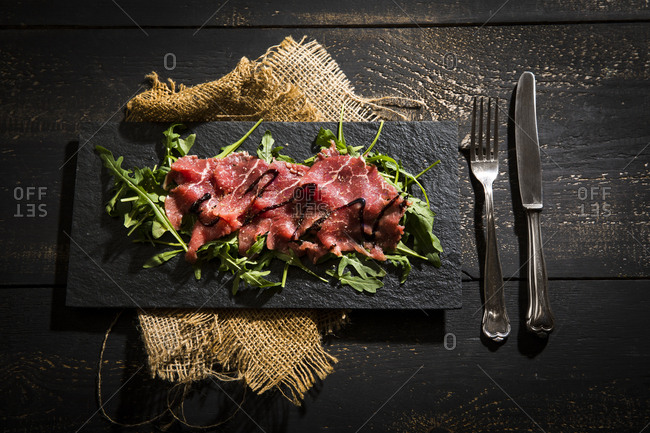 Beef carpaccio on rocket