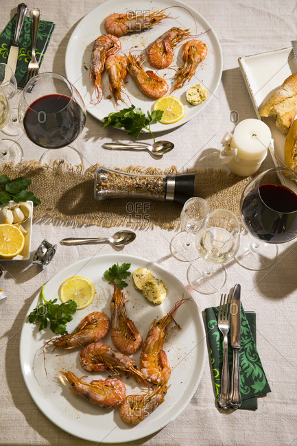 Argentine red shrimps on festive laid table