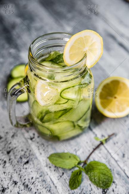 Detox water- cucumber water- lemon- mint in a glass