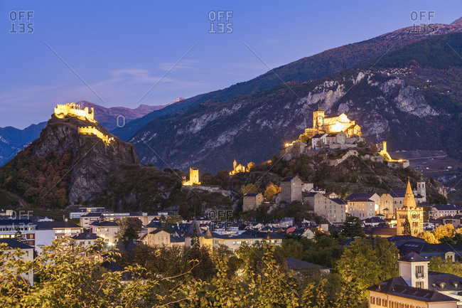 Switzerland- Canton Vaud- Sion- townscape with Tourbillon Castle- Notre-Dame de Valere and Notre Dame du Glarier at dusk