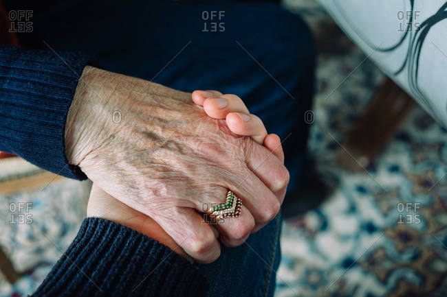 Close up of younger and elderly women's hands