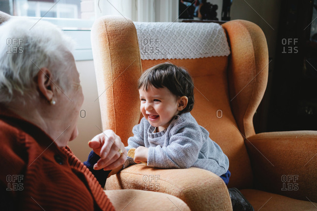 Happy granddaughter laughing with grandma