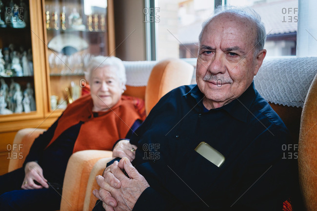 Elderly couple relaxing at home together