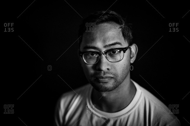 Dramatic portrait of man with glasses