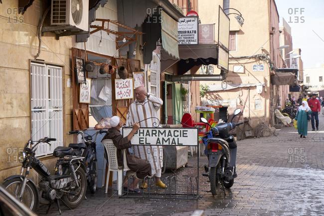 Marrakech, Morocco; 3 November 2017; Men having a conversation outside a store in the Medina