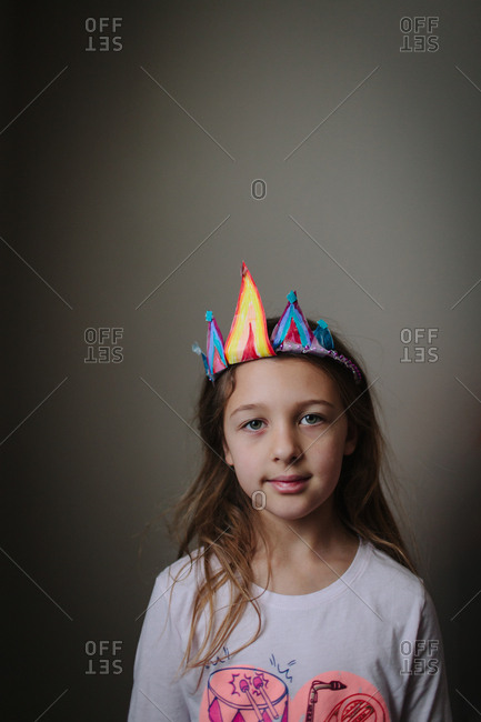 Preteen girl wearing homemade crown