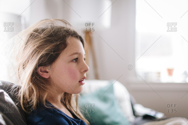 Girl staring thoughtfully across the room