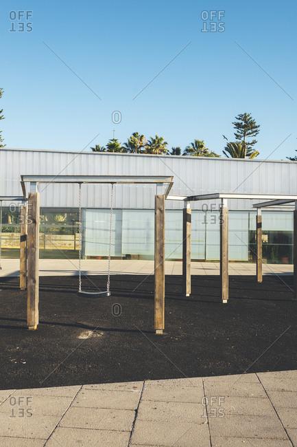 Swing set in an empty urban playground