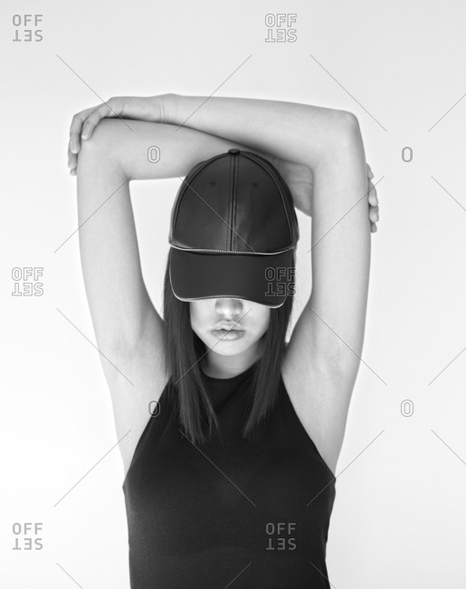 Pretty stylish Asian woman posing in studio