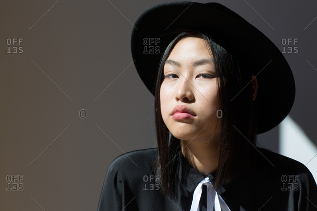Stylish Asian woman looking at camera