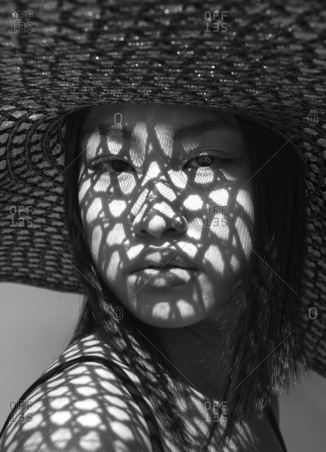 Asian woman in big hat