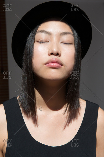 Stylish pretty Asian woman in hat