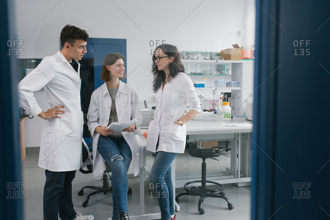 Workers communicating in lab