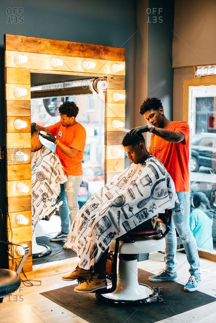 Barber using grooming machine
