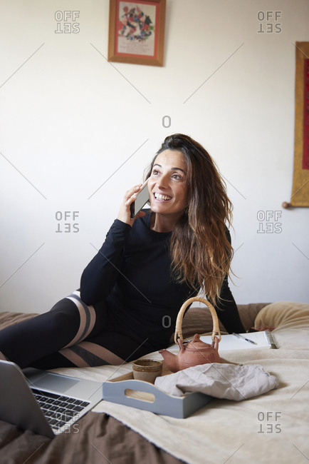 Woman laughing and talking on phone
