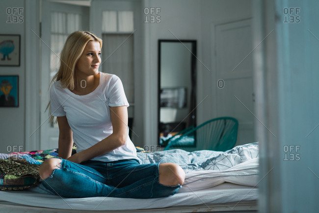 Woman on bed looking away