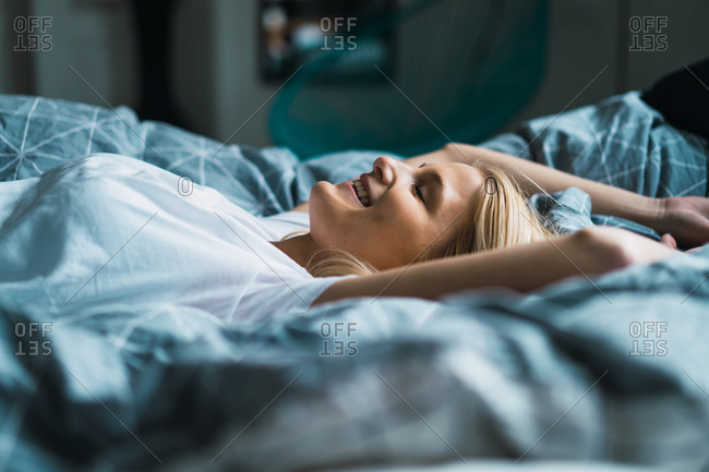 Blonde woman lying in bed