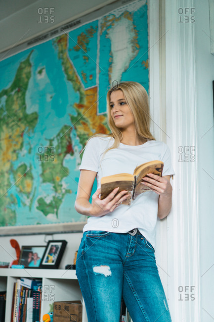 Woman with book at home