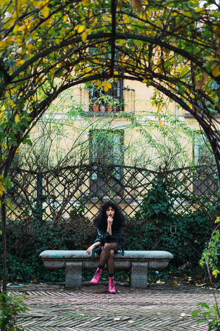 Woman on fence in park