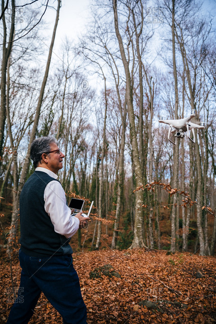Man flying a drone with his remote control