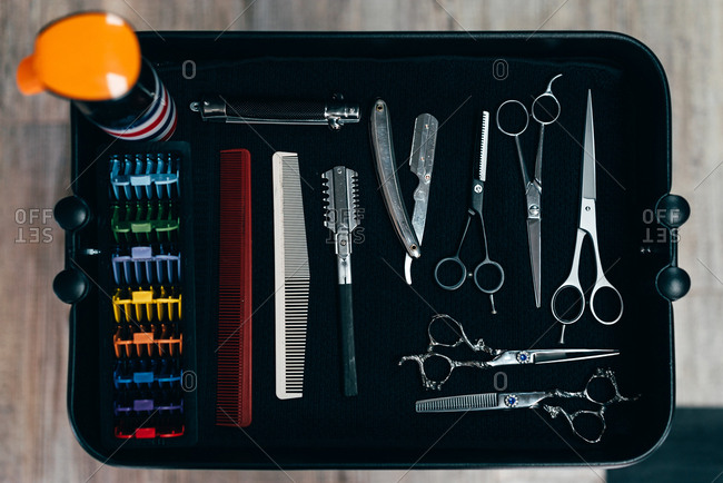 From above set of professional scissors and combs for barber in the shop