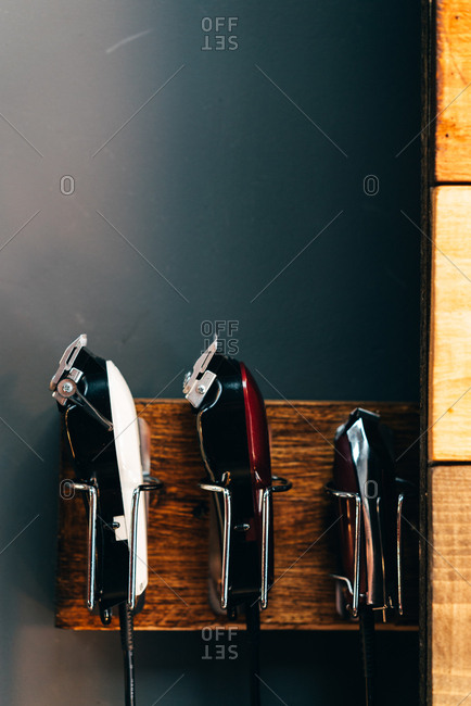 Set of different cutting machines in hangers in barbershop