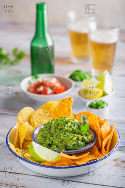 Typical mexican guacamole snack with nachos
