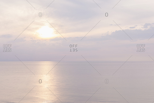 Dreamy sunrise across serene ocean