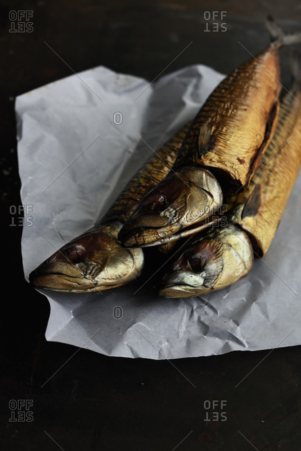 Whole smoked fish served on paper