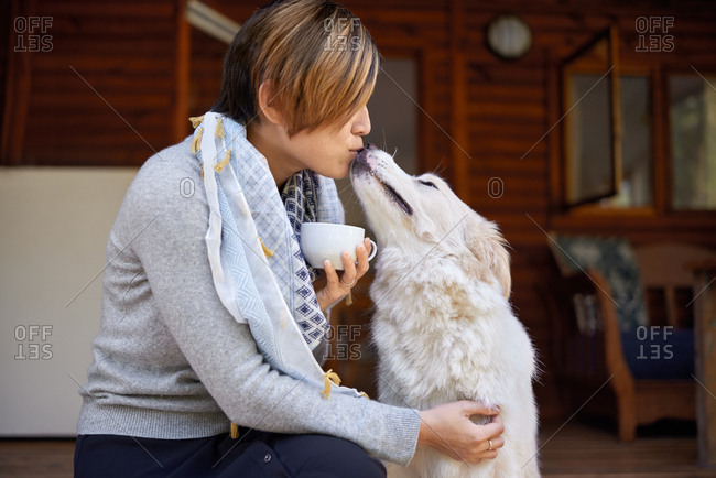 Woman bonding with pet dog, spending quality time outdoors affectionate pet owner