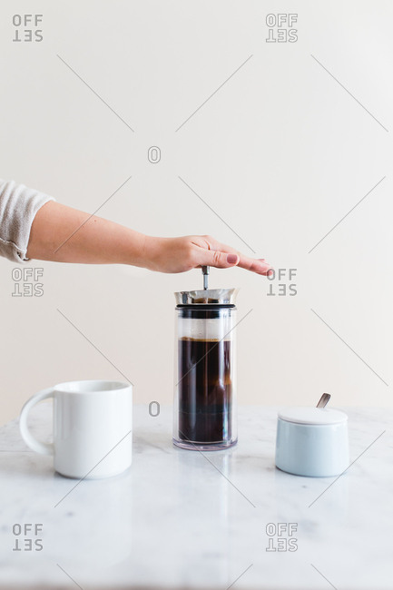 Person making coffee with a French press