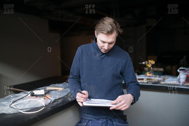 Man working on interior construction plans