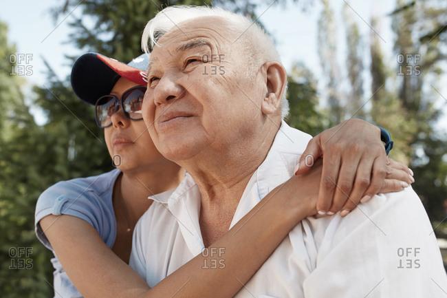 Adult daughter hugging her senior father