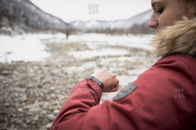 Young woman with smartwatch in winter