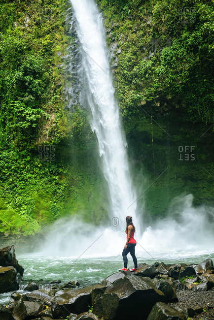 Costa Rica- Arenal Volcano National Park- Woman at the waterfall of La Fortuna